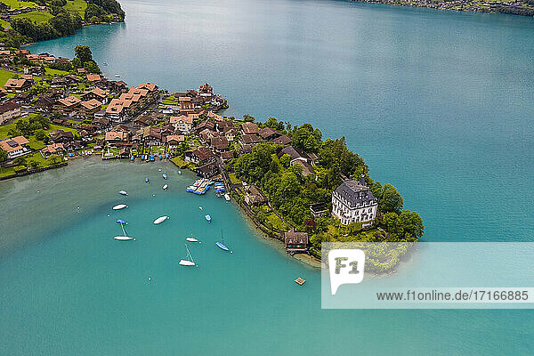 Switzerland  Brienz lake  Iseltwald  Aerial view of lake and village in mountains