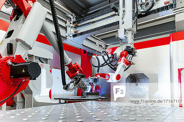 Automatic robotic equipment welding metal in factory