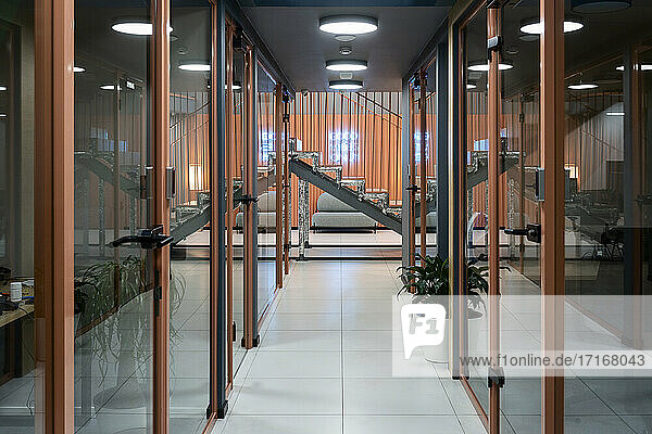 Interior of corridor by glass doors at workplace