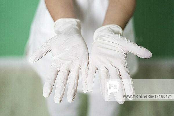 Female doctor's hands wearing white glove