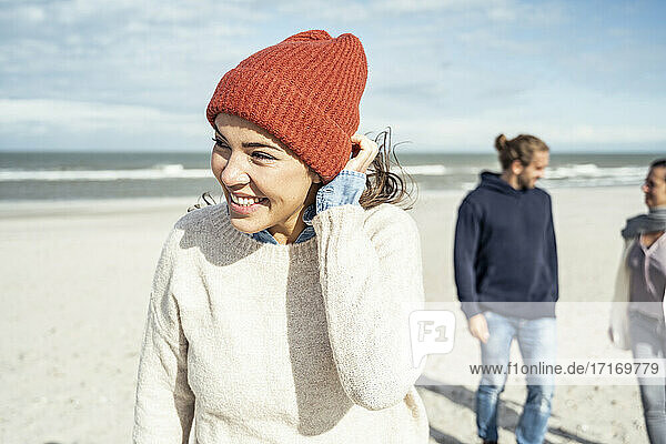 Portrait of woman knit hat standing on beach