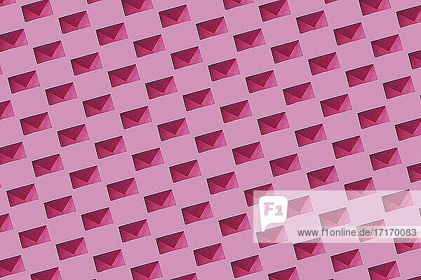 Pattern of rows of pink envelopes