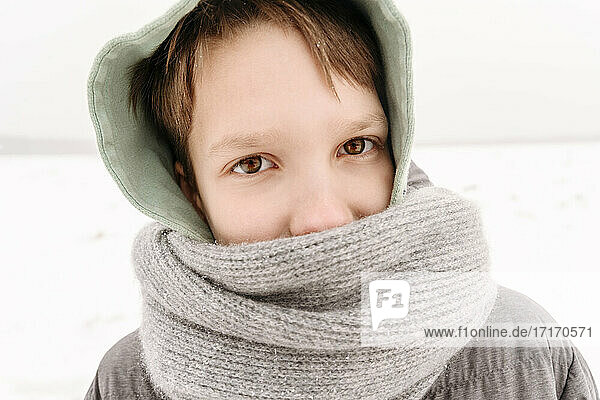 Close-up portrait of boy wearing scarf during winter