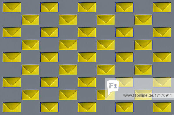 Pattern of rows of yellow envelopes