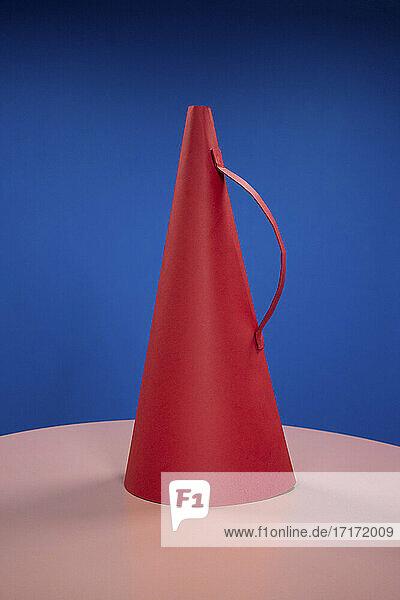Red megaphone against blue background