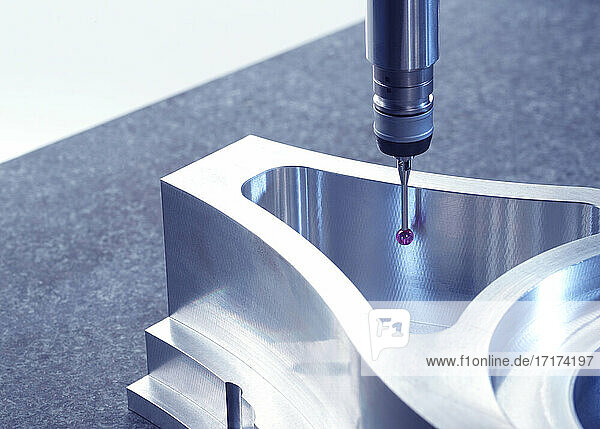 Engineering Metrology  A Property Released (PR)obe from a coordinate measurement machine taking measurements from a engineering part as part of its quality control Property Released (PR)ocess in manufacturing