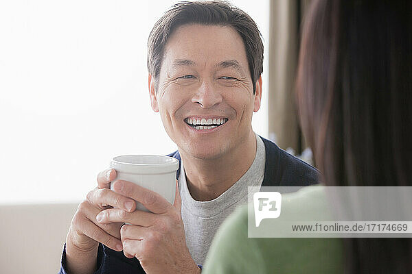 Mature couple  man holding coffee