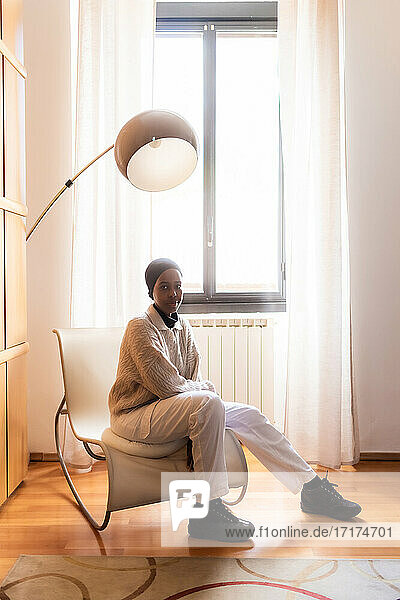 Portrait of young muslim woman at home