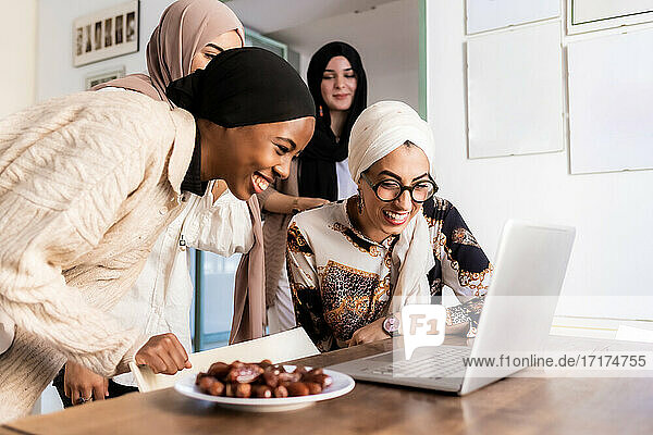 Young muslim women on video call  with plate of dates