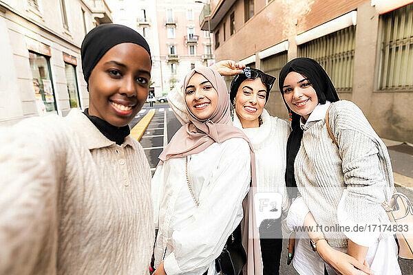 Four young women wearing hijab  taking selfie