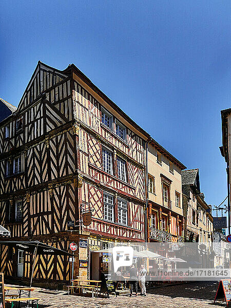 France. Rennes; city; Ille-et-Vilaine department  Brittany. In chapter street  tables are set in the pedestrian street for a drink or a meal. Tourists stroll to discover this old town. From the end of the Middle Ages to the end of the Ancien Régime  many half-timbered houses were built in Brittany  notably in Rennes  which still has 286 houses. Wood was an abundant and inexpensive material  which is why this construction technique was used extensively in the 14th-15th century  and continues to be used until the 18th century. This heritage is protected and restored. Most of these houses have little shops  bars and restaurants.