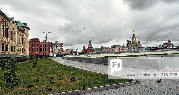 "Russia; .Yoshkar-Ola capital of the Republic of Mari El   along the Koshaga river. The Brugeal quay and the silhouette of the Cathedral new orthodox Church with beautiful golden domes has something in common with the architecture of St. Basil Cathedral in Moscow and the Cathedral of the Savior on Blood in St. Petersburg. is best known for its ""historical center  built in the 2000s in an incredibly eclectic spirit that looks unexpected in the typical Russian province."
