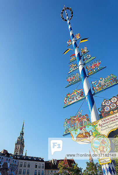 Munich. Germany  The Maypole medieval-style advertising pole  at the daily Victualien food market