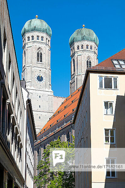 Germany  Munich  an alley of the old town with the Cathedral bell tower in the background