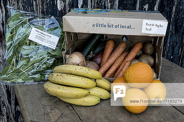 Close up of an organic fruit and vegetable box with a selection of fresh produce.