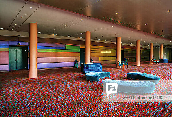 A large open space in a hospitality or business venue  conference centre hotel  public space.