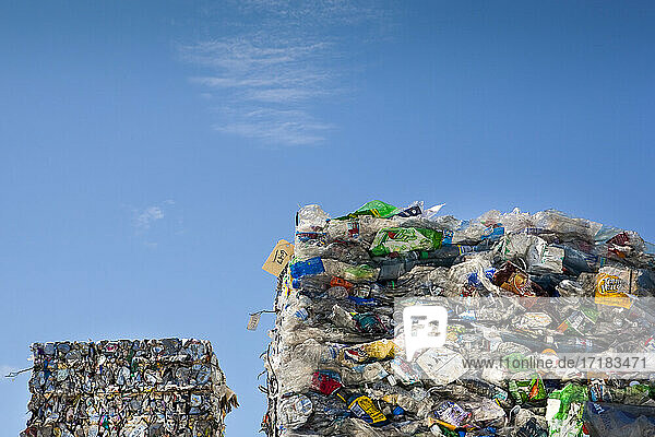 Commercial waste management  bales of recycling materials  plastics stacked up.