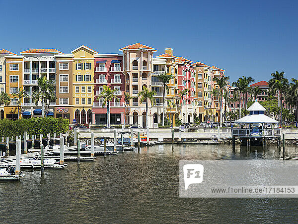 View across the Gordon River to the colourful architecture of Bayfront Place  Naples  Florida  United States of America  North America