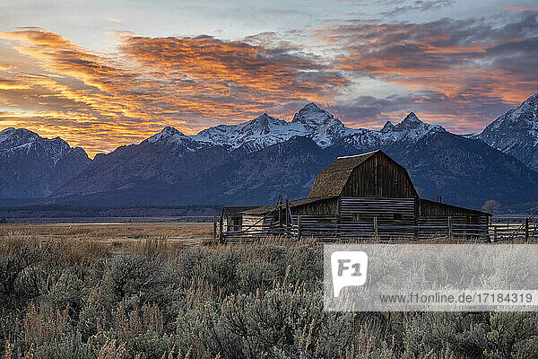 Sun setting over the Teton Range at Moulton Barn  Grand Teton National Park  Wyoming  United States of America  North America