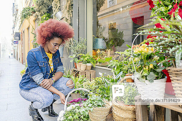 woman with afro hair in a flower shop