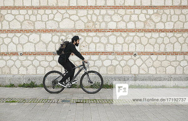Man Skateboarder with a bike Lifestyle Hipster Concept