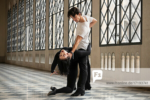 Man supporting flexible woman during dance