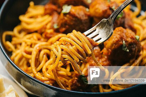 Spaghetti spun onto a fork closeup