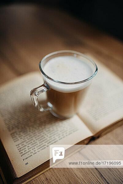 Coffee on old book closeup.