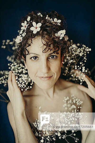 Female fashion model with white flowers in hair