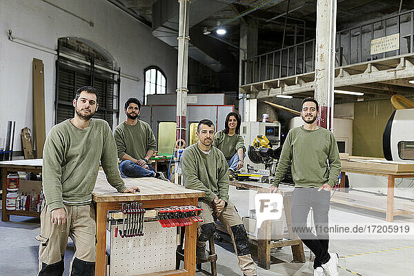 Male and female furniture designers at workshop
