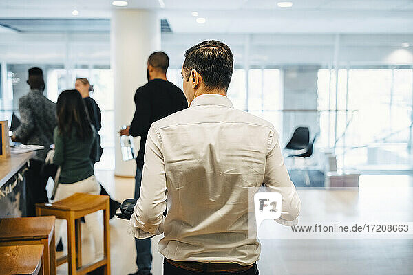 Male and female walking in office