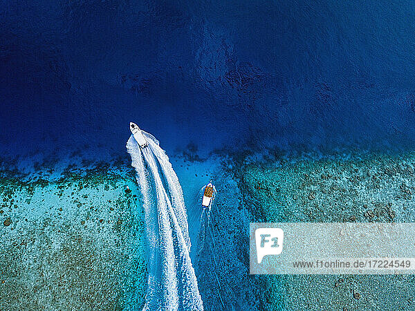 Aerial view of boats sailing near coast of Thulusdhoo island  Maldives
