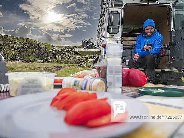 Male traveler camping with motor home at Holaskjol-Higlandcenter