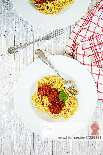 Plates of spaghetti with vegetarian mince balls