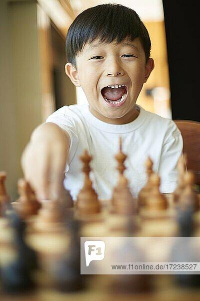 Japanese kid playing chess