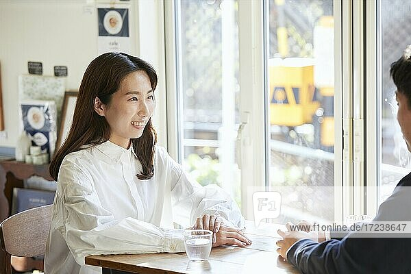 Young Japanese couple at a cafe