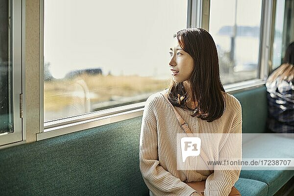 Young Japanese woman on a train
