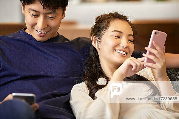 Young Japanese couple at home