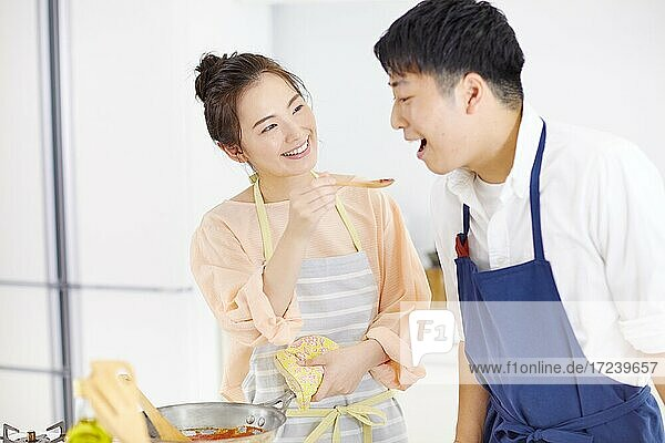 Young Japanese couple in the kitchen