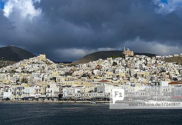 View of the town of Ermoupoli with harbour  on the hill the Basilica of San Giorgio in Ano Syros  and Anastasi Church or Church of the Resurrection  Syros  Cyclades  Greece  Europe