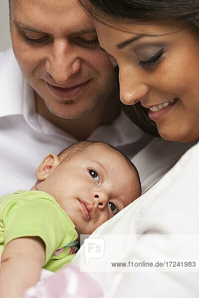 Happy young attractive mixed-race family with newborn baby