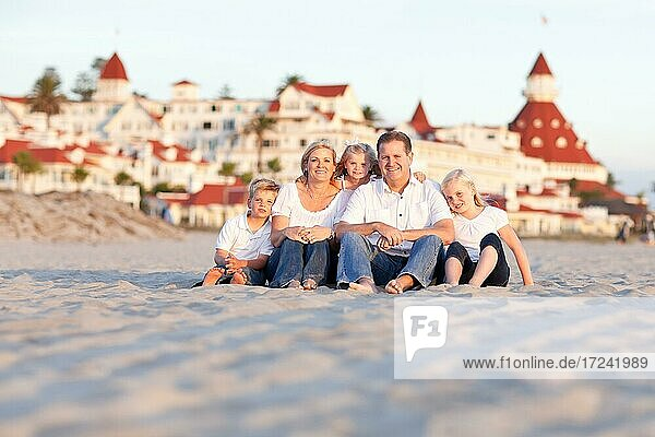 Happy caucasian family in front of hotel del coronado on a sunny afternoon