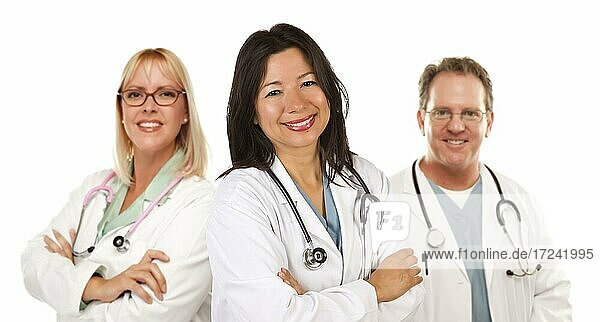 Friendly hispanic female doctor and colleagues before a white background