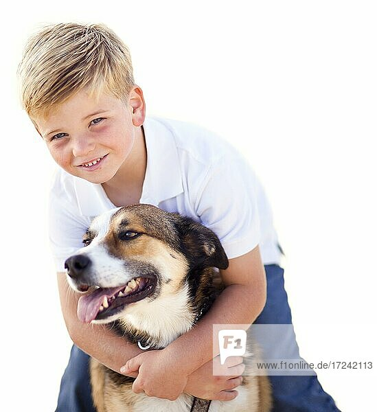 Handsome young boy playing with his dog isolated on a white background