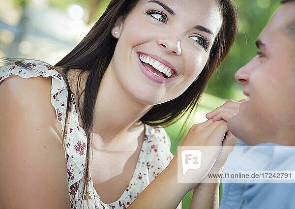 Happy mixed-race romantic couple portrait in the park