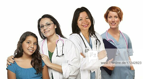 Pretty hispanic female doctor with child patient and colleagues before a white background