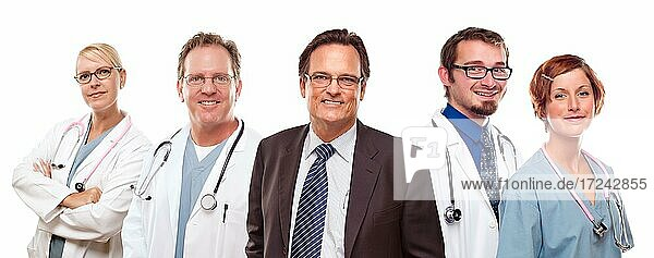 Smiling businessman with male and female doctors or nurses before a white background