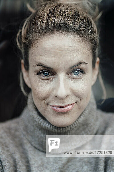 Smiling woman with blue eyes