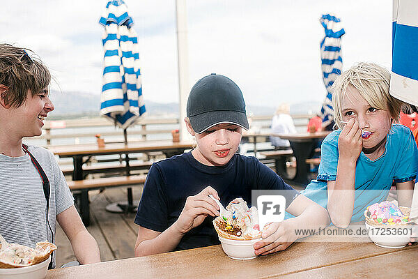 USA  California  Ventura  Children eating ice cream near beach