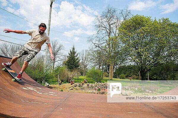 Canada  Ontario  Kingston  Man skateboarding in skate park